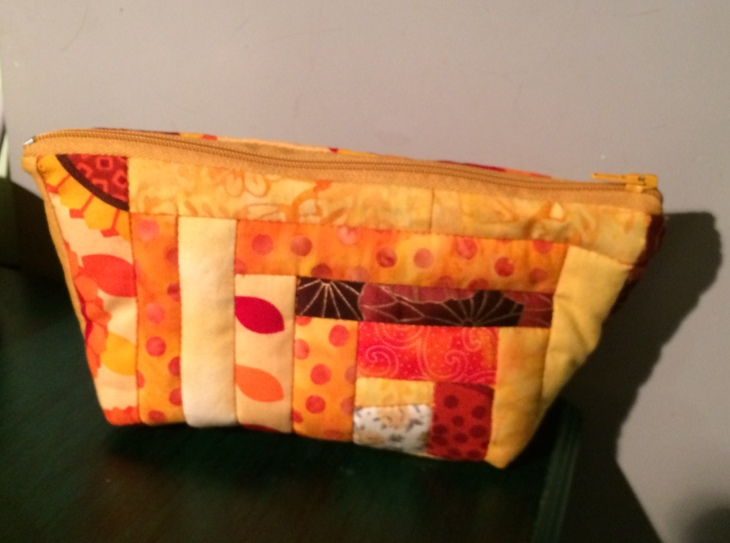 This pouch measures 8 x 4.5 inches (19.5 x 11.5 cm).