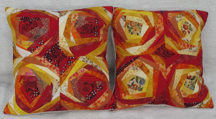 These two cushions consist of fabric ranging from yellow to red. They measure 16 inches (41 cm). £20.00 each or £35.00 for the pair.