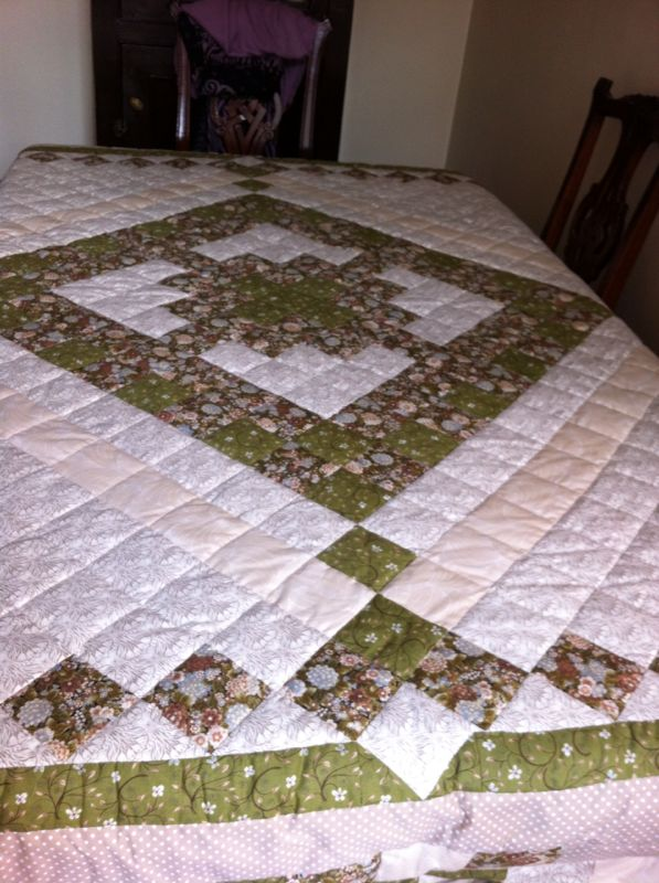 This table cloth was made on order. It measures 180 x 270 cm and has polyester batting. Sold.