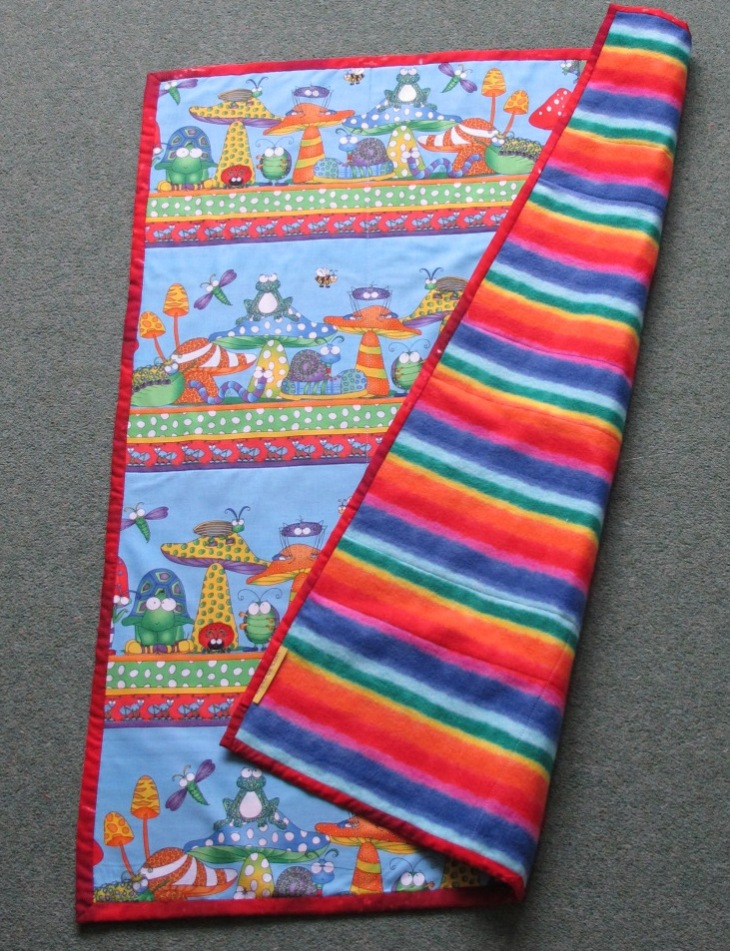 The back of the quilt is a rainbow-coloured fleece to keep the quilt light in weight.