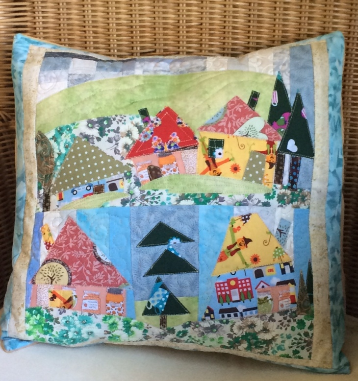 The cushion measures 14 x 14 inches (36 x 36 cm). £20.00.