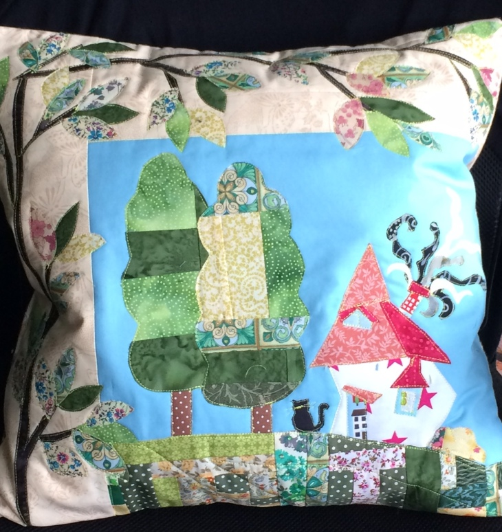 Bespoke order, this cushion measures 18 inches (46 cm) and features a crooked house with black cat.